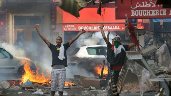 Pro-Palestinian protesters react during a demonstration against violence in the Gaza strip in Paris