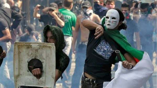 Pro-Palestinian protesters throw projectiles during a demonstration against violence in the Gaza strip in Paris