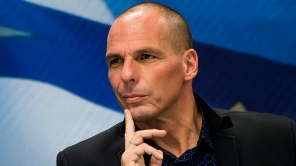 """Newly appointed Greek Finance Minister Yanis Varoufakis attends a hand over ceremony in Athens, January 28, 2015. Greece's finance minister on Wednesday said he plans to meet European counterparts to find a deal between the country and its creditors to replace the current bailout programme, stressing that one could be found without a """"duel"""" with Europe. REUTERS/Marko Djurica (GREECE - Tags: POLITICS BUSINESS) - RTR4NAUV"""