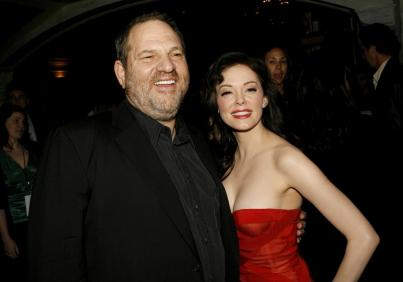 "LOS ANGELES, CA - MARCH 26: Producer Harvey Weinstein (L) and actress Rose McGowan arrive to the premiere of ""Grindhouse"" at the Orpheum Theatre on March 26, 2007 in Los Angeles, California. (Photo by Kevin Winter/Getty Images) *** Local Caption *** Harvey Weinstein;Rose McGowan"